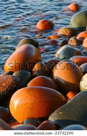 Lake Superior boulders at sunrise - stock photo
