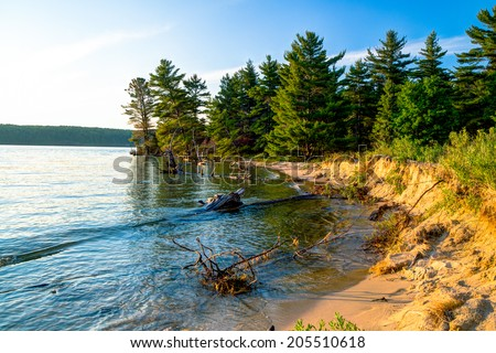 Lake Superior Coast. Remote wooded shoreline of wild and pristine Lake Superior. Pictured Rocks National Lakeshore. Munising, Michigan.    - stock photo