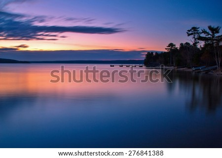 Lake Superior Dawn. Sunrise reflections along the shores of a calm Lake Superior.  - stock photo