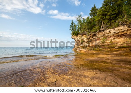 Lake Superior shoreline - Rocky outcroppings define the shoreline of Pictured Rocks National Lakeshore near Au Train Michigan. - stock photo