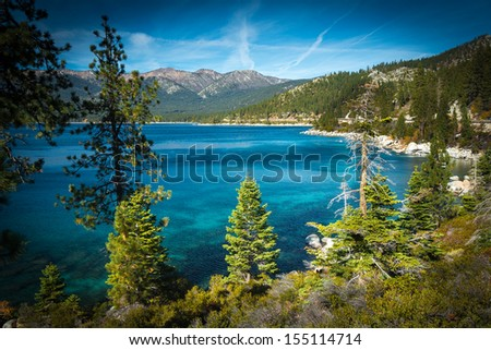 Lake surrounded by mountains, Lake Tahoe, California, USA - stock photo