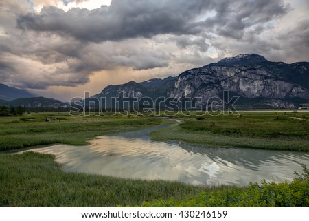 Lake swamp mountainous background on cloudy stock photo 430246159 lake swamp with a mountainous background on a cloudy sunset taken in squamish thecheapjerseys Gallery