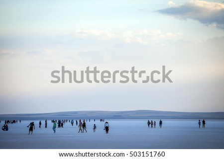 Lake Tuz, Turkey - September 25, 2016: Color image of people walking on Tuz salt lake in Turkey. Lake Tuz (Tuz Golu) is one of the largest hypersaline lakes in the world.
