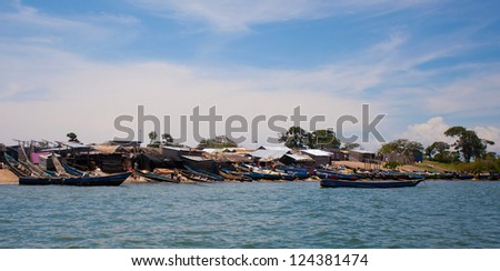 LAKE VICTORIA, UGANDA - OCT 19: Small fishing village on an island on October 19, 2012, Lake Victoria, Uganda, Africa. Fishing is the most important source of income for local people at Lake Victoria. - stock photo