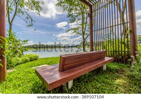 lake view from a bench - stock photo