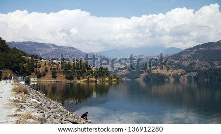 lake view in pokhara area - begnas tal lake with the reflect