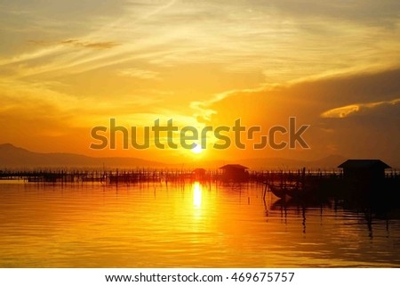 Lake view on sunset time at Thailand,colorful cloud with sky and water reflect  at lake,select focus with shallow depth of field:ideal use for background.