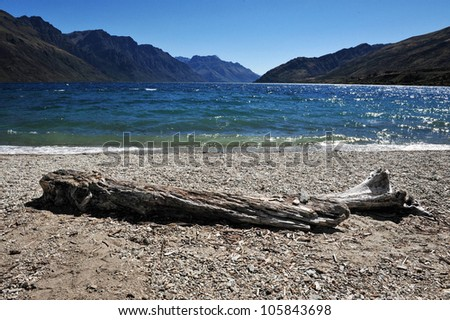 Lake Wakatipu is a long thin Z-shaped lake formed by glacial processes, and has spectacular views of nearby mountains. - stock photo