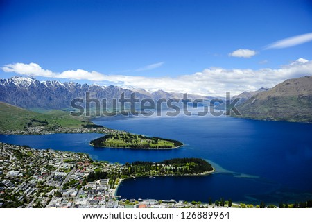 Lake Wakatipu with Queenstown in the foreground, New Zealand. - stock photo