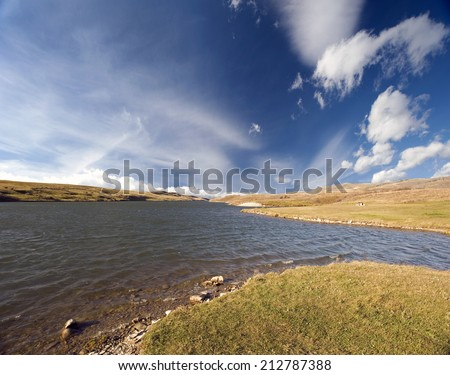 Lake with clouds - Yellow Lake in the Canadian province of Saskatchewan - stock photo