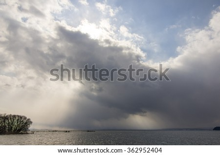Lake with cloudy sky