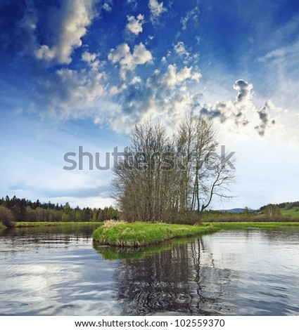 lake with little island - stock photo