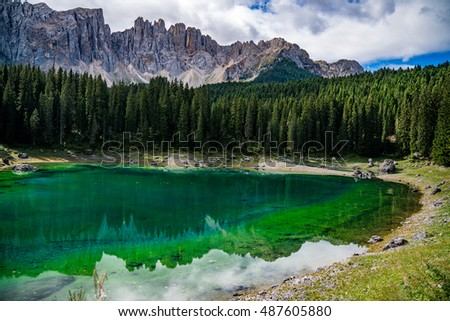 Lake with mountain forest landscape, Lago di Carezza. Trentino Alto Adige. Italy