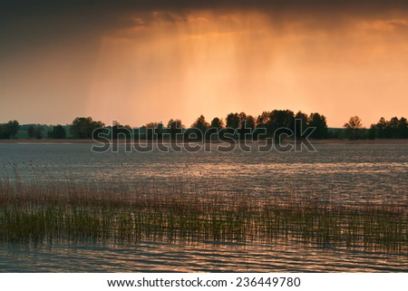 Lake with sunset landscape - stock photo