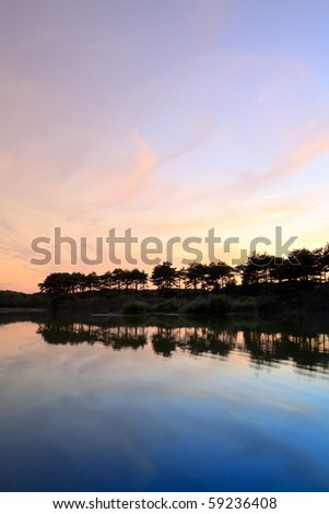 Lake with trees at sunset