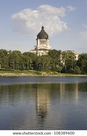 Lake with view of South Dakota State Capitol and complex, Pierre, South Dakota - stock photo