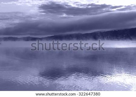 Lake Worth (Worthersee) at sunrise. Austria. Blue toned image. - stock photo