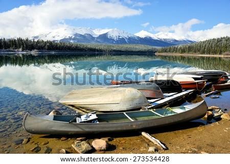 Lake, yellow grass and mountain view in Jasper National Park, Alberta, Canada, Unesco World Heritage - stock photo