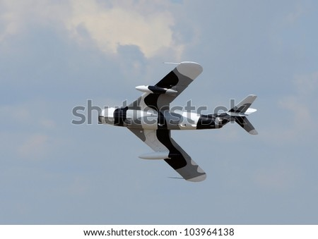 LAKELAND, FLORIDA - APRIL 1: Cold Was era Soviet Mig-17 jet fighter performs practice flights for upcoming aviation expo in Lakeland, Florida, USA on April 1, 2012 - stock photo