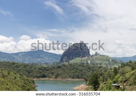 Lakes and islands in Guatape with the Piedra el Penol with blue cloudy sky, near Medellin, Colombia. - stock photo