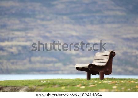 Lakeside bench - stock photo