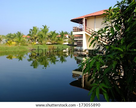 Lakeside in the backwaters of Kerala, India. - stock photo