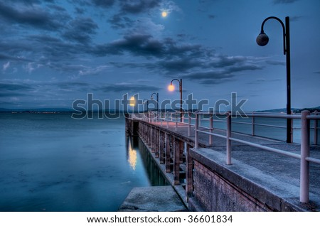 Lakeside pier before sunrise - stock photo