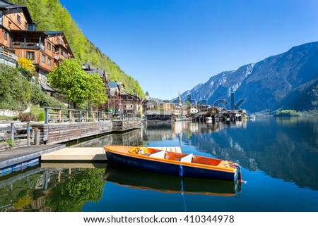 Lakeside promenade with boat at Hallstatt, Salzkammergut, Upper Austria - stock photo