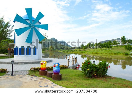 Lakeside View and wind turbine - stock photo