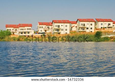 Lakeside villas - stock photo