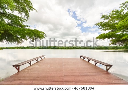 Lakeside with wooden deck and benches extended out into water