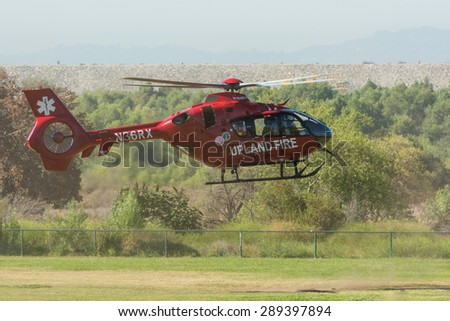 Lakeview Terrace, CA, USA - June 20, 2015: Upland Fire Department helicopter during Los Angeles American Heroes Air Show, event designed to educate the public about rotary-wing aviation.