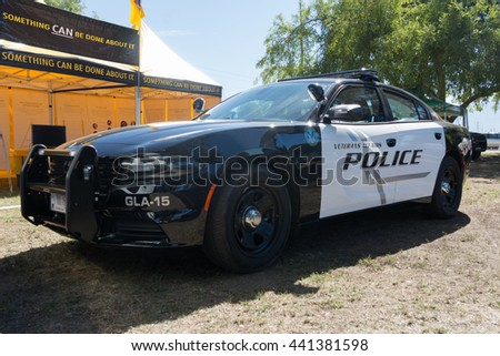Lakeview Terrace, USA - June 18, 2016: Dodge Charger police car during Los Angeles American Heroes Air Show, event designed to educate the public about rotary-wing aviation. - stock photo