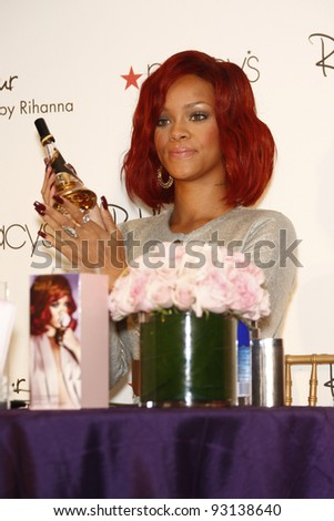 LAKEWOOD, CA - FEB 18: Rihanna arrives at Macy's in Lakewood, California at the launch of her first fragrance 'Reb'l Fleur' on February 18, 2011. - stock photo