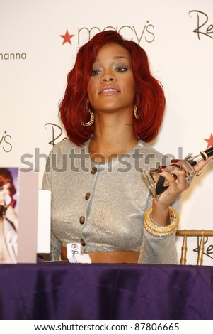 LAKEWOOD, CA - FEB 16: Rihanna at Macy?s in Lakewood, California at the launch of her first fragrance 'Reb?l Fleur' on February 16, 2011 - stock photo