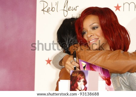 LAKEWOOD, CA - FEB 18: Rihanna at Macy's in Lakewood, California at the launch of her first fragrance 'Reb'l Fleur' on February 18, 2011. - stock photo