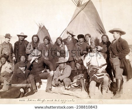 Lakota (Brule, Miniconjou, and Oglala) chiefs and U.S. officials in front of tipis at Pine Ridge Reservation. Pine Ridge, South Dakota. Photo by John C. Grabill. 1891