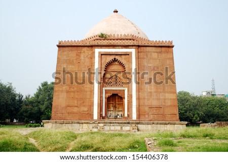 Lal Gumbad, New Delhi. Lal Gumbad is the tomb of Shaikh Kabiru�d-Din Auliya, a Sufi Saint. - stock photo