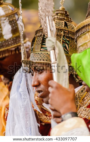 LALIBELA, ETHIOPIA - SEP 27, 2011:  Unidentified Ethiopian beautiful girl with golden crown the Meskel festival performance in Ehtiopia, Sep 27, 2011. Meskel commemorates the finding of the True Cross