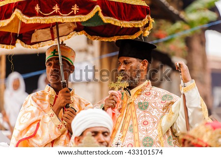 LALIBELA, ETHIOPIA - SEP 27, 2011: Unidentified Ethiopian priest holds the golden cross during the Meskel festival in Ehtiopia, Sep 27, 2011. Meskel commemorates the finding of the True Cross