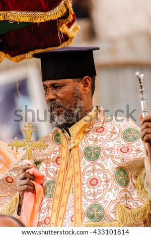 LALIBELA, ETHIOPIA - SEP 27, 2011: Unidentified Ethiopian priest pronounces the speech during the Meskel festival in Ehtiopia, Sep 27, 2011. Meskel commemorates the finding of the True Cross