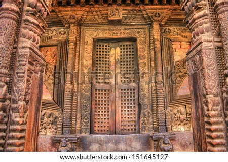 Lalitpur (Patan) in Nepal. Building exterior with old door / gate at Durbar Square.