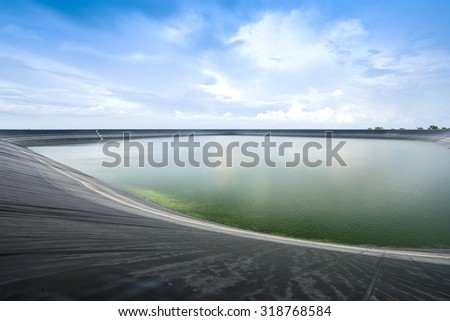 Lam Takong reservoir (water reservoir with plastic liner), Nakhon Ratchasima, Thailand - stock photo