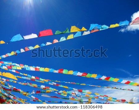 Lama Buddhist prayer flags in the highlands of Tibet - stock photo