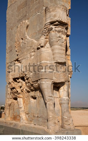 Lamassu, an Assyrian protective deity, often depicted as having a human's head, a body of an ox or a lion, and bird's wings; guarding the ancient Gate of All Nations in Persepolis of Shiraz. - stock photo