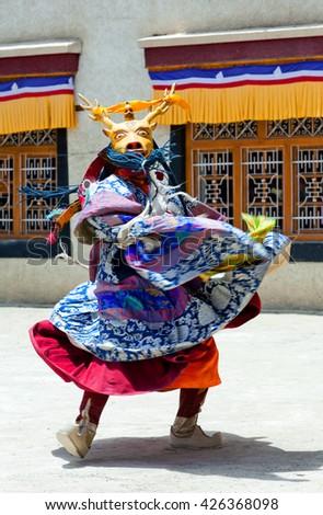 LAMAYURU, INDIA - JUNE 17, 2012: Buddhist monk in Deer mask dancing Cham dance during Yuru Kabgyat festival at Lamayuru Gompa in Ladakh, Jammu and Kashmir, North India - stock photo
