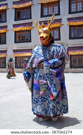 LAMAYURU, INDIA - JUNE 17, 2012: Buddhist monk in Deer mask dancing Cham mystery during Yuru Kabgyat festival at Lamayuru Gompa in Ladakh, Jammu and Kashmir, North India - stock photo