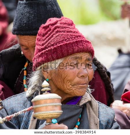 LAMAYURU, INDIA - JUNE 13, 2015: Unidentified buddhist old people during mystical mask dancing Tsam mystery dance in time of Yuru Kabgyat Buddhist festival at Lamayuru Gompa, Ladakh, North India - stock photo