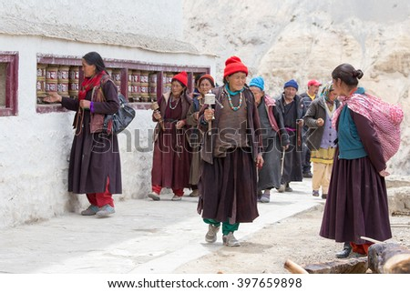 LAMAYURU, INDIA - JUNE 15, 2015: Unidentified buddhist old women during mystical mask dancing Tsam mystery dance in time of Yuru Kabgyat Buddhist festival at Lamayuru Gompa, Ladakh, North India - stock photo