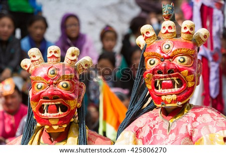 Lamayuru, India - June 17, 2012: unidentified monks perform a religious masked and costumed mystery dance of Tibetan Buddhism during the Cham Dance Festival in Lamayuru monastery, India. - stock photo